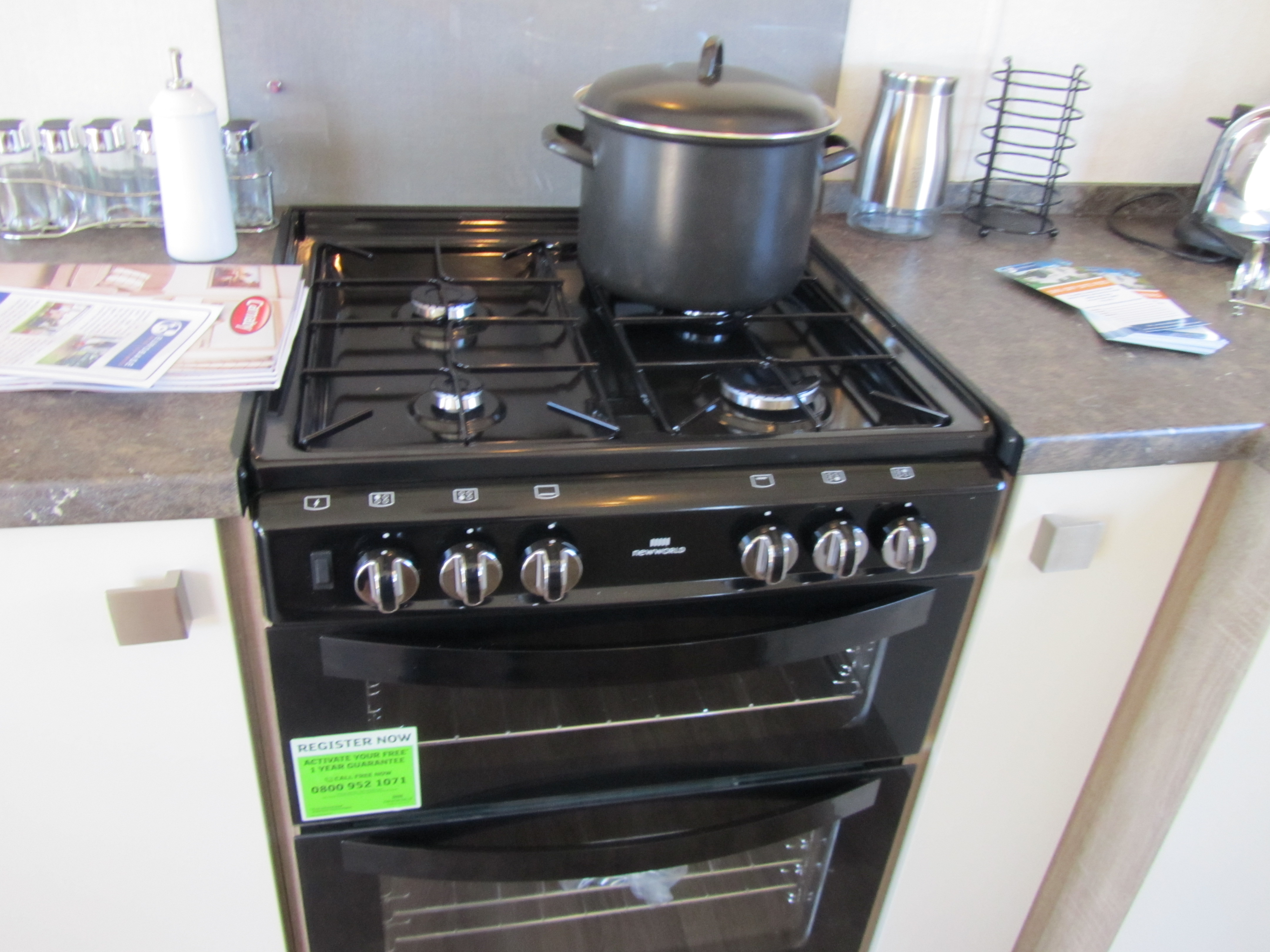 gas cooker with double electric fan assessed oven.