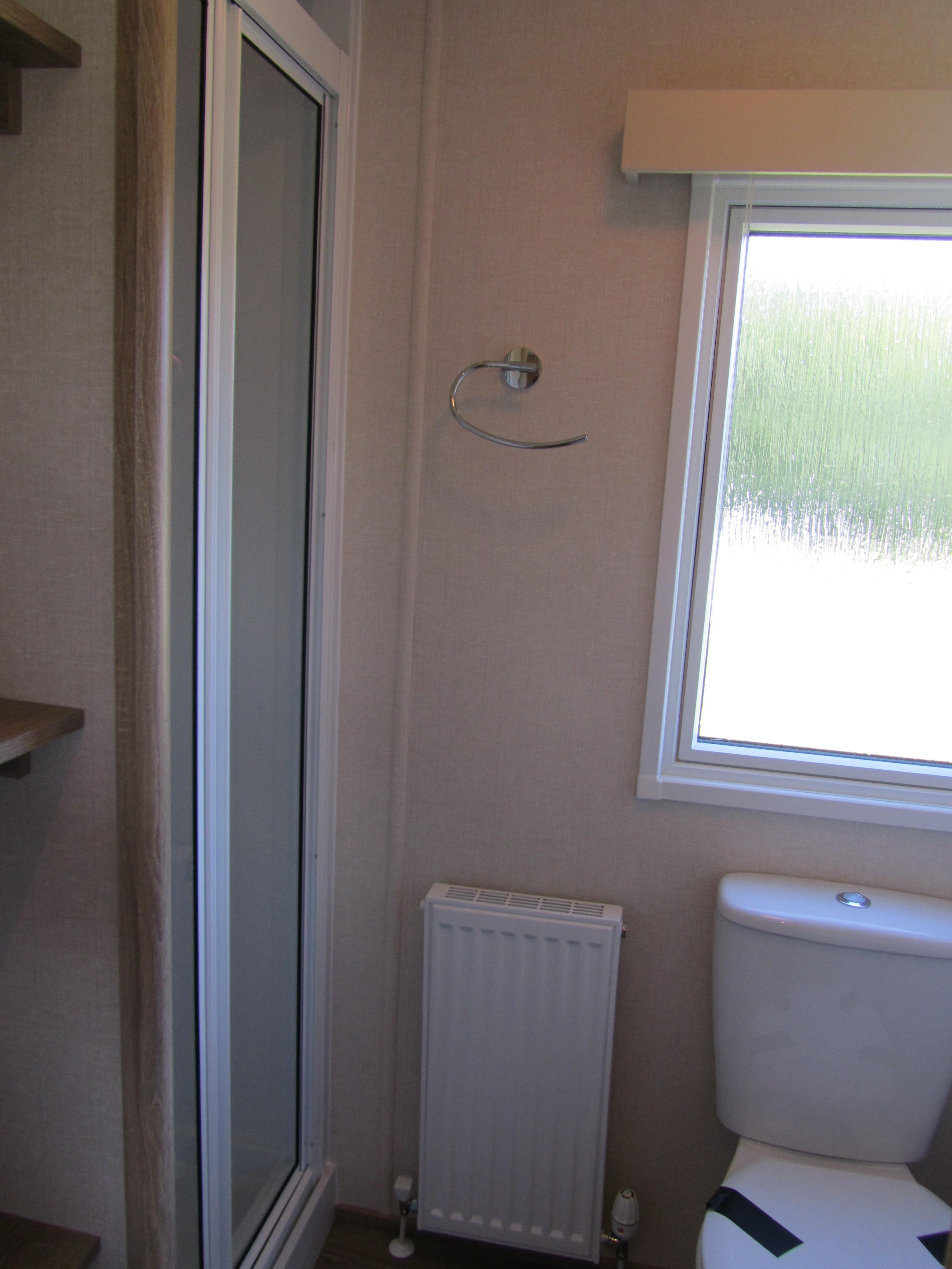 Toilet & shower next to twin bedrooms