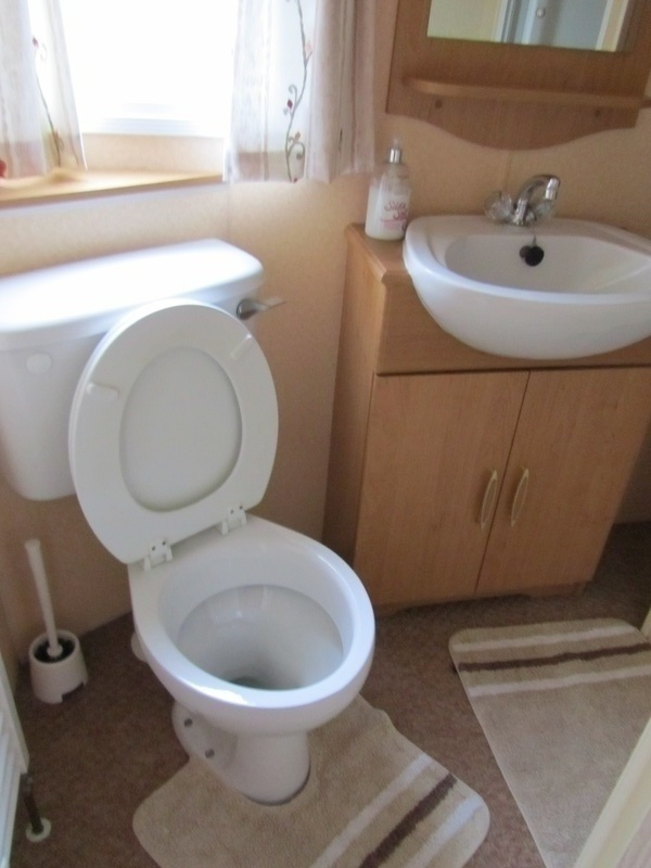 Shower room with second toilet.